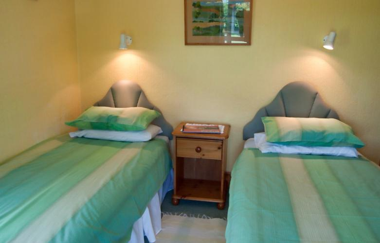 spacious twin bedroom with lovely countryside views