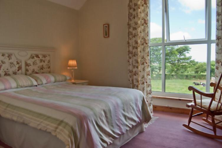 Spacious double bedroom with lovely countryside and coastal views