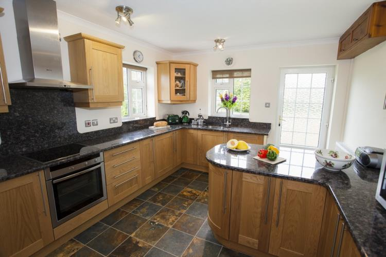 Spacious kitchen with NEFF dishwasher, w.machine, electric hob, oven and microwave. Fridge and Freezer