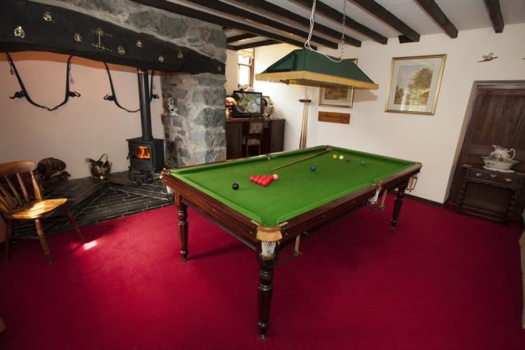 Snooker Room  with wood burner in an ingle-nook at Betws Bach Farmhouse