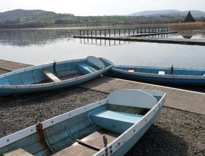 Llangorse lake with boats, Brecon Beacons in background