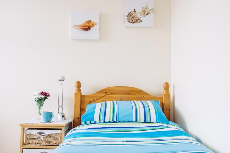 Single adjoining guest bedroom that can be booked with  the adjoining double room as twin or triple