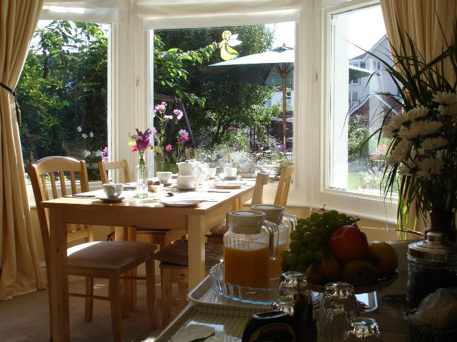 The sunny Breakfast room in Lymehurst B & B which looks on to the garden.