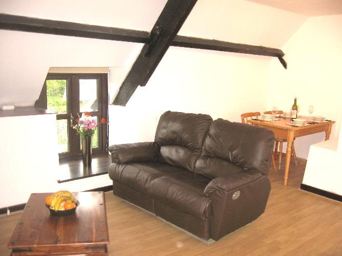 Oak Beamed Lounge with dinning area in alcove at Bluebell Loft