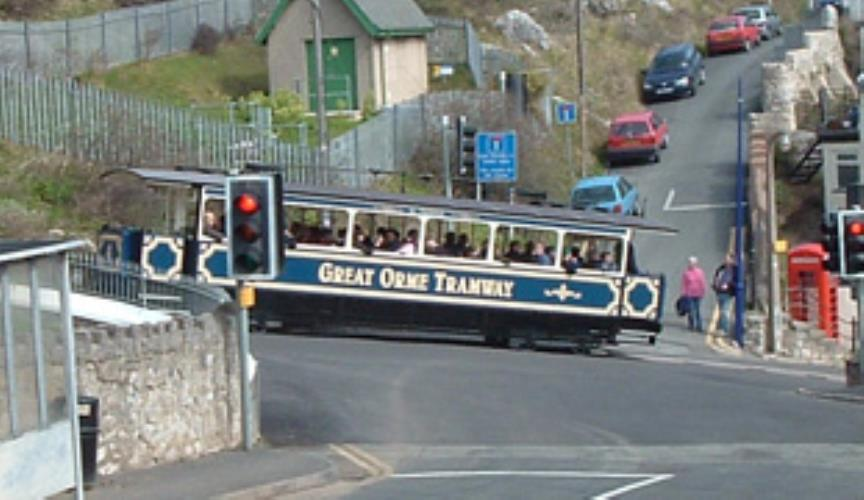 The Great Orme Tram passing at the bottom of the road