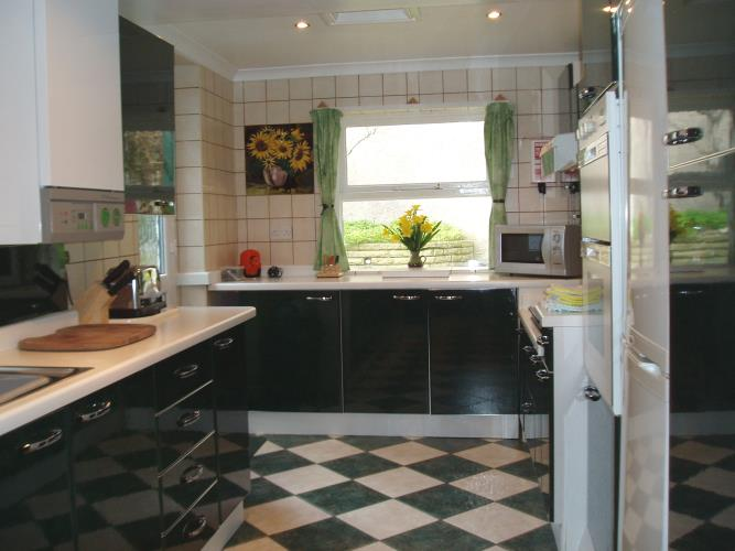 Fully equipped kitchen including double oven and large fridge/freezer