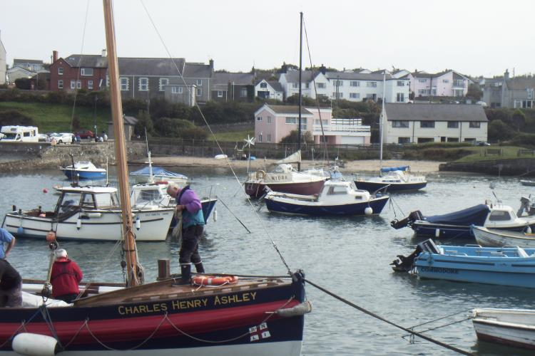View across harbour to old school house