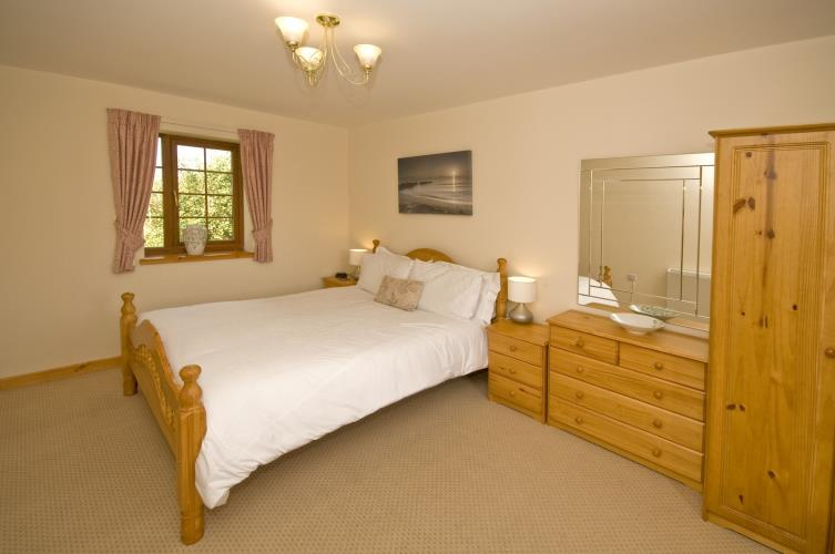 Cerrig y barcud holiday cottages idyllic setting anglesey photo gallery Master bedroom with a crib