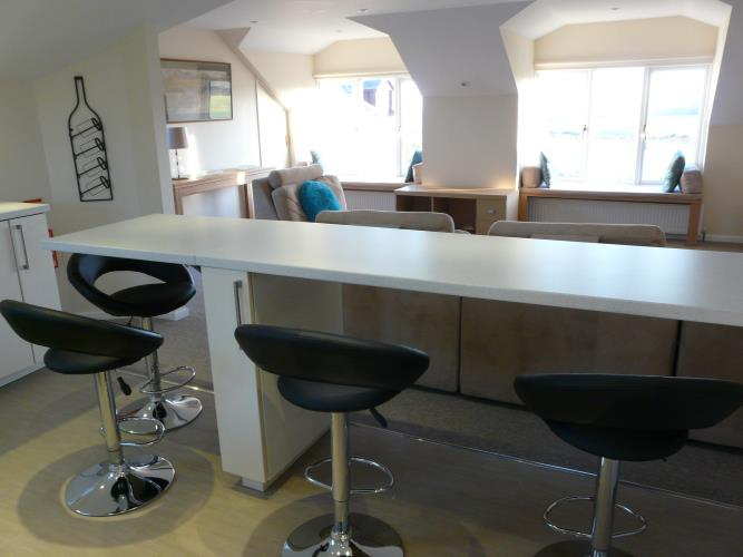 Breakfast bar and living area - Seashells Cottage Moelfre - Anglesey Coastal Holiday Cottage - Lligwy Beach