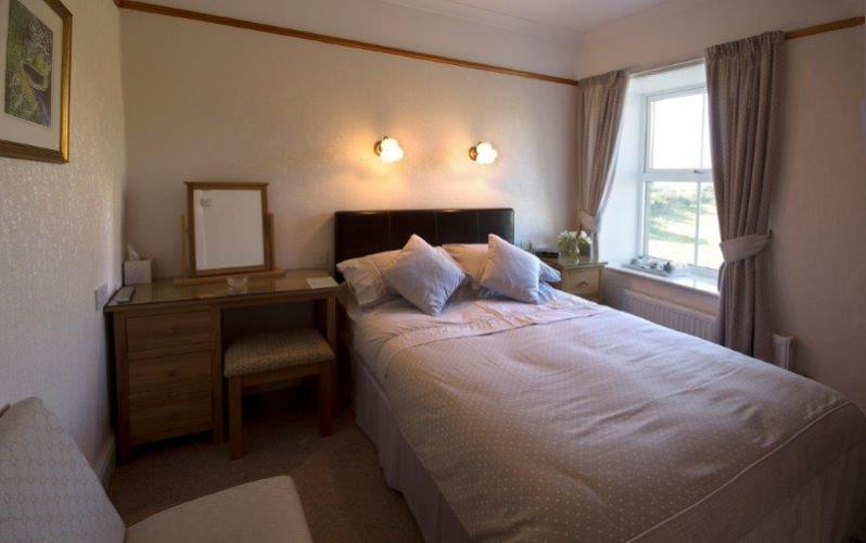 a double bedroom with views over the fields to the Lleyn peninsula in the distance