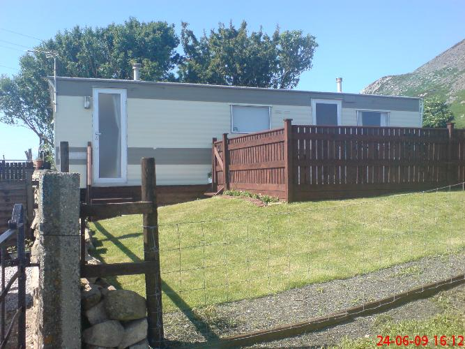 Side view of caravan and decking