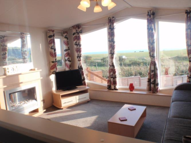 Spacious lounge with fantastic views of the surrounding landscape & Cardigan bay